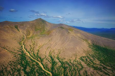 Kamchatka. Wild nature. Green fields and volcanoes