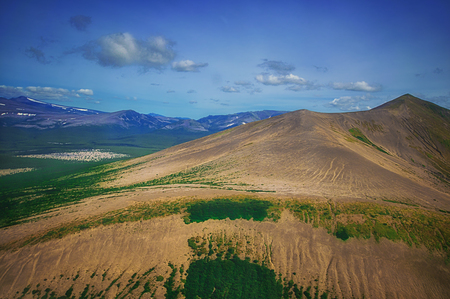 Kamchatka. Wild nature. Green fields and volcanoes