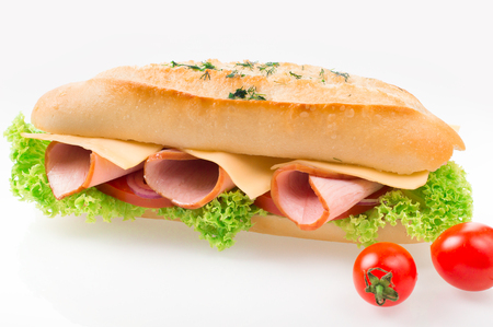 Sandwich with ham and vegetables isolated on white background. Stock Photo