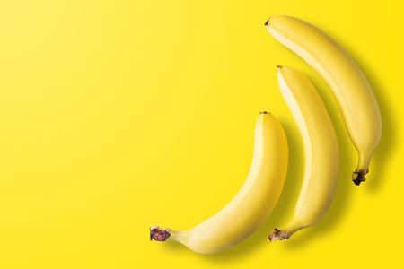 Bananas on pastel yellow background. Minimal fashion. Albino Different Creativity Creative Thinking Ideas Concept. Free space for text