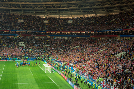 MOSCOW, RUSSIA - July 11, 2018: Football fans celebrating during the FIFA 2018 World Cup in the semi finals football match between England and Croatia at Luzhniki Stadium