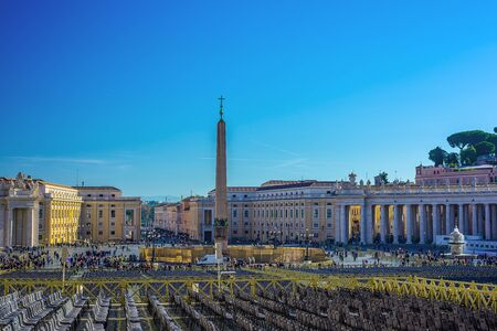 The St. Peters basilica is seen at St. Peters square in Vatican City, Vatican Редакционное