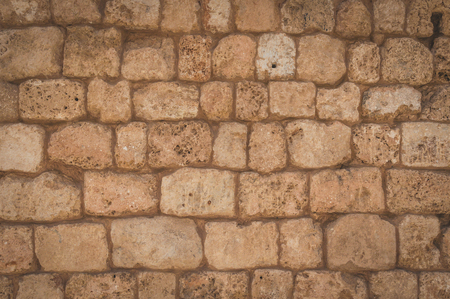 Old beige stone wall background texture close up. Wall from near the sea in the port of Tel Aviv Archivio Fotografico - 123043362