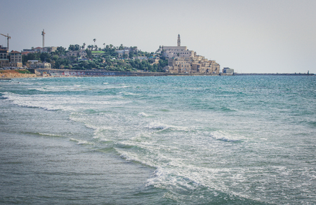 View from the shore of the Mediterranean Sea on Old Jaffa, Tel Aviv, Israel Фото со стока - 123040370