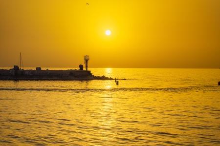 Evening Jaffa old port at sunset of the day. Tel Aviv Yafo Israel. Фото со стока