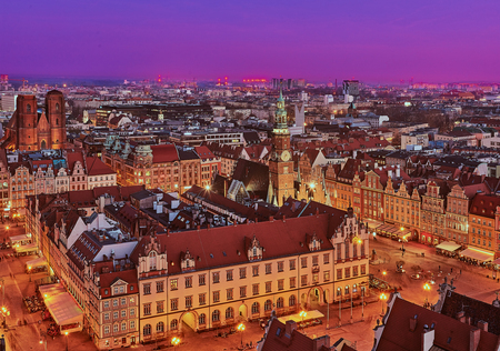 Aerial view of the sunset of Stare Miasto with Market Square, Old Town Hall and St. Elizabeths Church from St. Mary Magdalene Church in Wroclaw, Poland Фото со стока