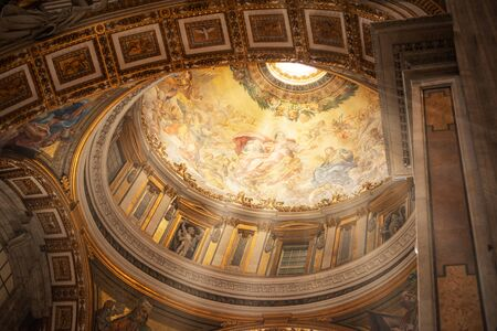VATICAN - November 11, 2018: Inside the St. Peters Basilica, Rome, Italy. St Peters church San Pietro is one of the main landmarks in Rome. St Peters interior in sun rays.
