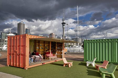 Auckland New Zealand. The skyline from Viaduct Harbour and a library in a container