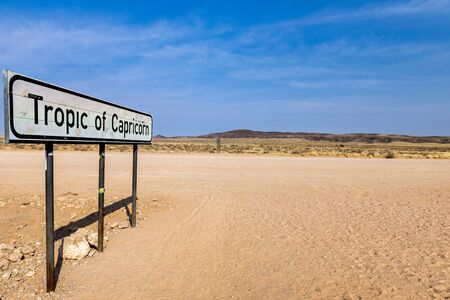 Namibia, Africa. Crossing Tropic of Capricorn on a gravel road Stock Photo