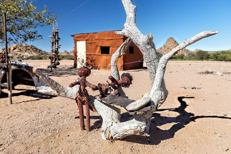 Namibia, Africa. Woodoo dolls in the desert
