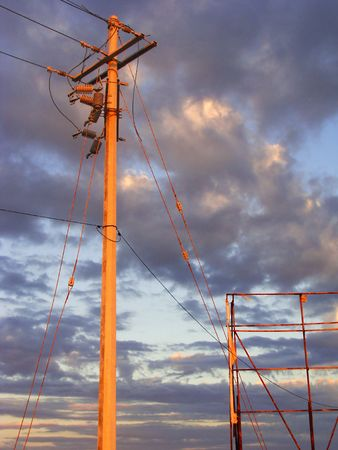 Electricity post, cables and metal structure with a purple cloudy afternoon sky Stock Photo - 8201384