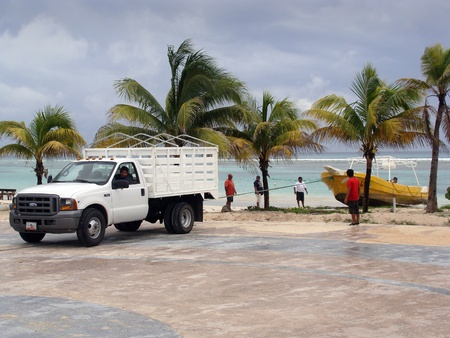 Mahahual, Quintana Roo, Mexico, october 26 2011: Fishing boat precautionarily pulled from water due to passing hurricane Rina offshore.