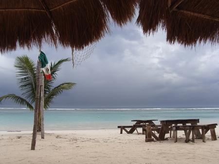 roo: Mahahual, Quintana Roo, Mexico, october 26 2011: Empty beach due to passing hurricane Rina offshore.