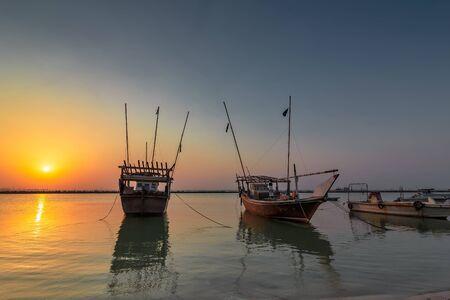 Beautiful Sunrise Boat in seaside with yellow and blue sky background. Dammam -Saudi Arabia