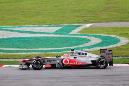 Sepang, MALAYSIA- April10, 2011 - Jenson Button driving his Mcalren-Mercedes during the formula one race at the sepang circuit Stock Photo - 10185842