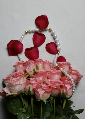 peal: Beautiful fress pink bunch of roses with peal set meant for love affection between male and female Stock Photo