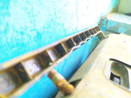Vintage old radio FM instrument handle and broken antenna with turquoise blue background