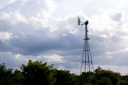 a view of weather vane tower isolated in nature