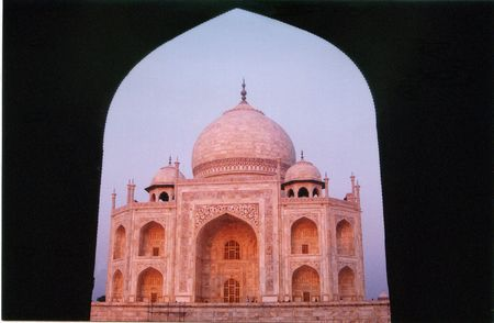 appears: Tajmahal appears in different shades at different time as sunlight falls on it.In early morning it appears pinkish. Stock Photo