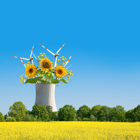 reactor: Alternative Energies; Photomontage of nuclear reactor as a vase for sunflowers and windmills Stock Photo