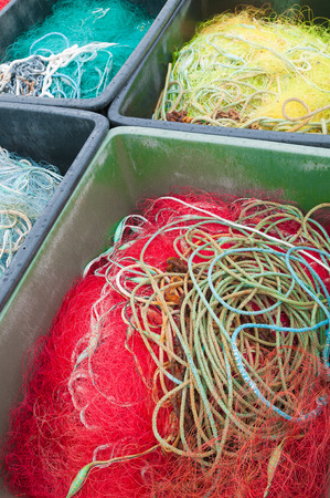 meshed: Different colored fishing nets Arranged in plastic boxes; Fishing equipment Stock Photo