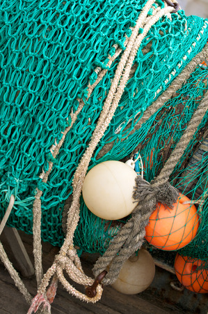 edible fish: Fishing equipment; Turquoise fishing net with ropes and plastic floats; Fishing industry