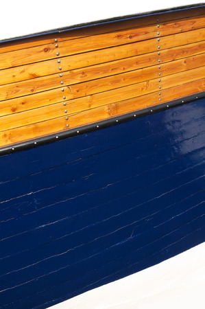 shipbuilding: Varnished wood hull of boat with nails, wood texture for background