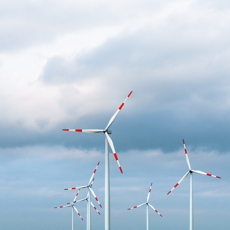 onshore: Wind turbines against cloudy sky; Wind power Stock Photo