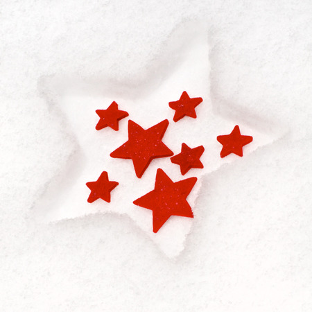 red star: Red felt stars in different sizes in th snow; Christmas decoration Stock Photo