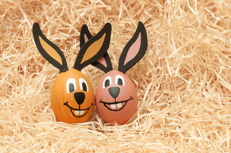 nearness: Hand painted Easter eggs in straw bunny