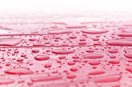 evaporate: Raindrops on pink plastic foil in close up shot; Wrong Weather Forecast