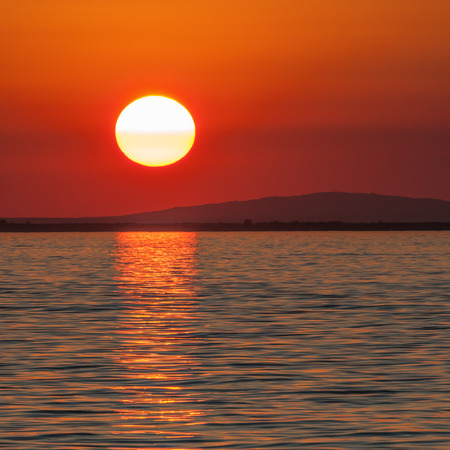 closing time: Red sky at sunset over Lake Constance, picture-perfect idyll Stock Photo