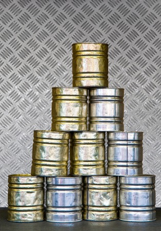 to toss: Stack of empty tin cans for ball toss game; Pastime at funfair or childrens party