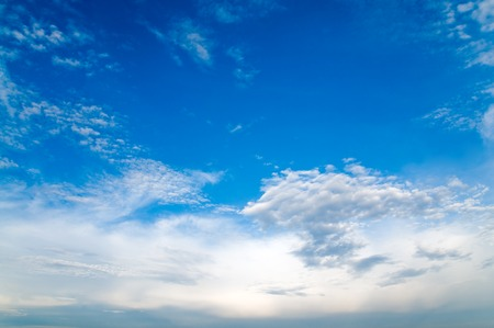 cloud formation: Emerging cloud formation; Cloudscape with blue sky