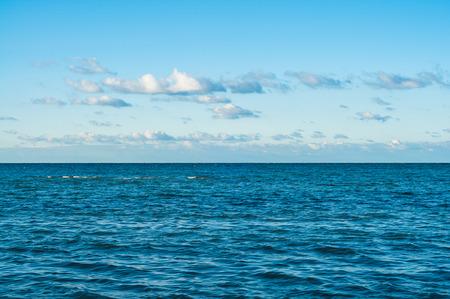 salinity: Moved dark ocean at slightly clouded sky