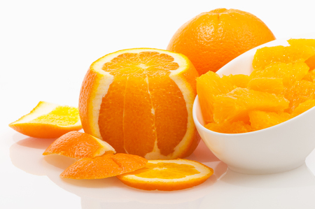 Oranges - whole fruit, orange pulp in slices and orange zest against white background; Ingredients for delicious jam or dessert