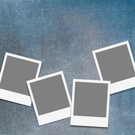 analogous: Four blank instant photo frames on scratched, old chalkboard; Set of empty snap shot frames on blew-gray background
