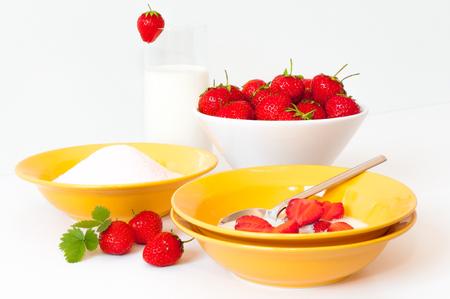 Fresh strawberries, milk and sugar for sweet and tasty dessert; Fruit; Taste of summer
