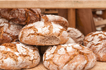 Fresh bread for the breakfast; Basic foodstuff; Loaves of crusty bread; Bakery; Bakers trade; Food production Stock Photo