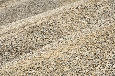 Montón de grava en primer plano para el fondo o la textura; Almacenamiento de materiales a granel; Materiales de construcción; Industria de la construcción