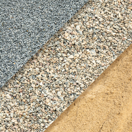 aggregates: Fine gray grit, gravel and bright light brown sand for background or texture; Different materials for construction or horticulture in top view; Building materials;