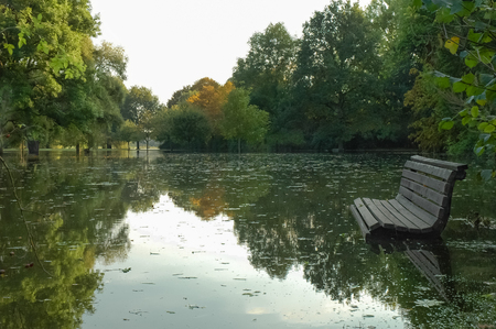 Flooded park; Flooding of local recreation area; Flooded park with swamped bench; Natural disaster