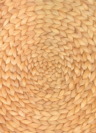 Round woven water hyacinth mat in close up for background or texture; Round place mat of natural material