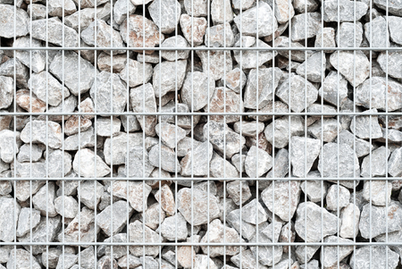 gabion mesh: Natural stone wall made of wire mesh and crushed rocks; Building materials industry; Gabion box for background Stock Photo