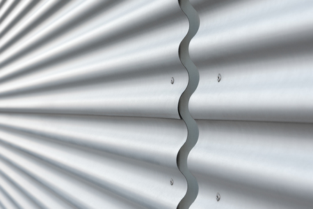 Modern wall covering with corrugated metal sheets; Construction element of modern building; Construction materials industry; Silver corrugated metal for background