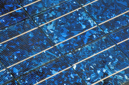 Blue shining solar panel in close up for background; Use of solar energy; Alternative energy production Stock Photo