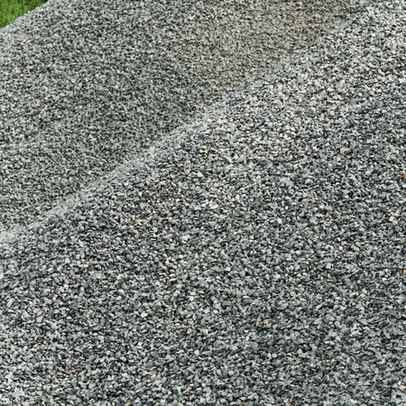 Pile of fine gray gravel; Product of building materials trade; Raw material for construction industry