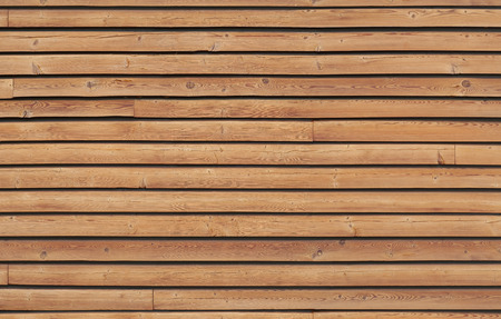 Wall cladding with brown wooden slats; Natural materials for wall covering; Wall paneling with horizontal slats