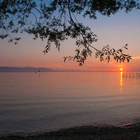 deceleration: Atmospheric sundown over Lake Constance; Evening mood at lake shor in summer; Holiday memories