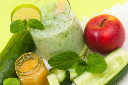 Healthy cucumber smoothie with apple and honey and mint leaves; Healthy drink made of vegetable and fruit; Low-carb fitness drink Stock Photo